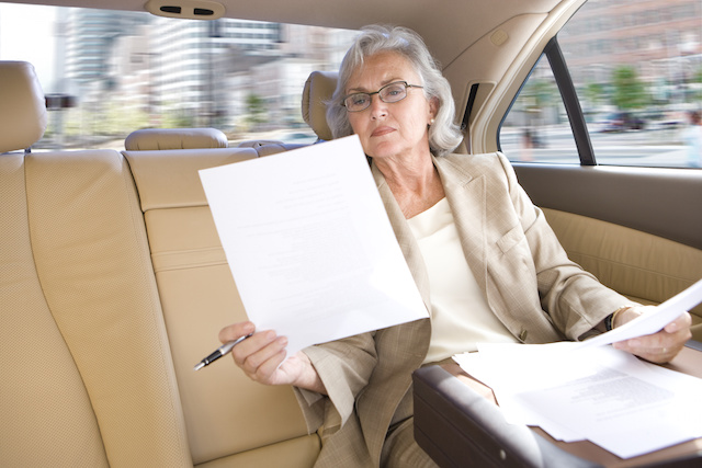 Businesswoman riding in town car